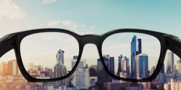 Behind a glasses lens